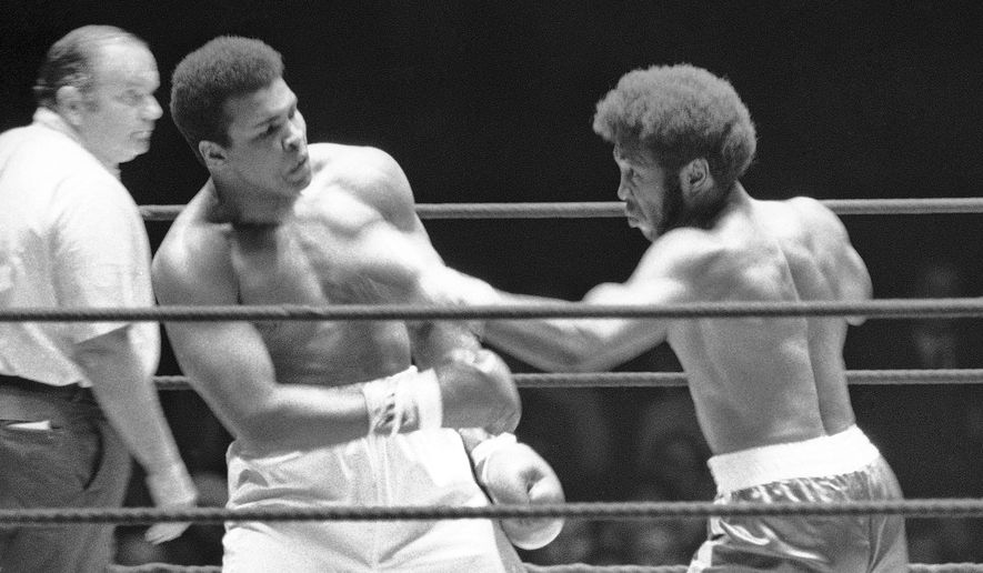 FILE - In this July 27, 1971, file photo, Referee Jay Edson, left, keeps an eye on the fight between Muhammad Ali and Jimmy Ellis, right, in the 12th round of their heavyweight fight in Houston. Ellis, a former heavyweight boxing champion who trained with fellow Louisville fighter Muhammad Ali and squared off against some of his era's best fighters, has died in his hometown Tuesday, May 6, 2014. He was 74. Ellis' brother, Jerry, said the ex-champion died at a Louisville hospital Tuesday after suffering from Alzheimer's disease in recent years. (AP Photo/File)