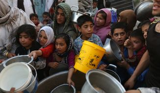 Afghan villagers receive free food donated by other villagers as they prepare to break their fast during the holy month of Ramadan in Kabul, Afghanistan, Thursday, June 9, 2016. Muslims across the world are observing the holy fasting month of Ramadan, when they refrain from eating, drinking and smoking from dawn to dusk. (AP Photo/Rahmat Gul)