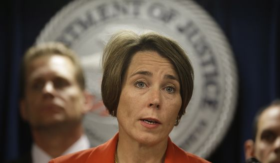 Massachusetts Attorney General Maura Healey responds to questions from reporters during a news conference at the federal courthouse, Thursday, June 9, 2016, in Boston. Law enforcement officials say more than 60 alleged gang members from Boston and other cities in eastern Massachusetts have been charged with drug, weapons and racketeering charges. (AP Photo/Steven Senne)