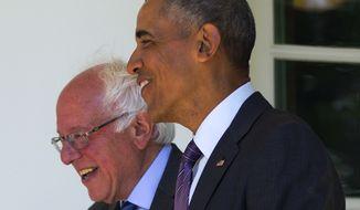 President Barack Obama walks with Democratic presidential candidate Sen. Bernie Sanders, I-Vt., down the Colonnade of the White House in Washington, Thursday, June 9, 2016. (AP Photo/Pablo Martinez Monsivais)