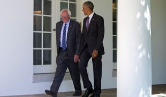 President Barack Obama walks with Democratic presidential candidate Sen. Bernie Sanders, I-Vt., down the Colonnade of the White House in Washington, Thursday, June 9, 2016. (AP Photo/Pablo Martinez Monsivais)