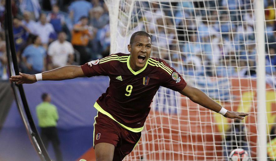 Venezuela's Salomon Rondon reacts after scoring a goal during the first half of a Copa America Group C soccer match against Uruguay on Thursday, June 9, 2016, in Philadelphia. (AP Photo/Matt Slocum)