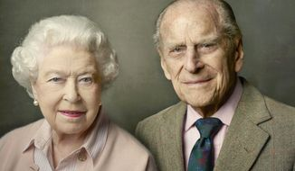 In this undated photo released by Buckingham Palace on Friday, June 10, 2016, Britain's Queen Elizabeth II, left and Prince Philip, the Duke of Edinburgh pose for a photograph to mark the Queen's 90th birthday, in Windsor, England. The queen, Britain's oldest and longest-reigning monarch, turned 90 on April 21. She usually celebrates her birthday privately, but this year's milestone served as the jumping off point for weeks of celebrations. (Annie Leibovitz/ Buckingham Palace via AP)
