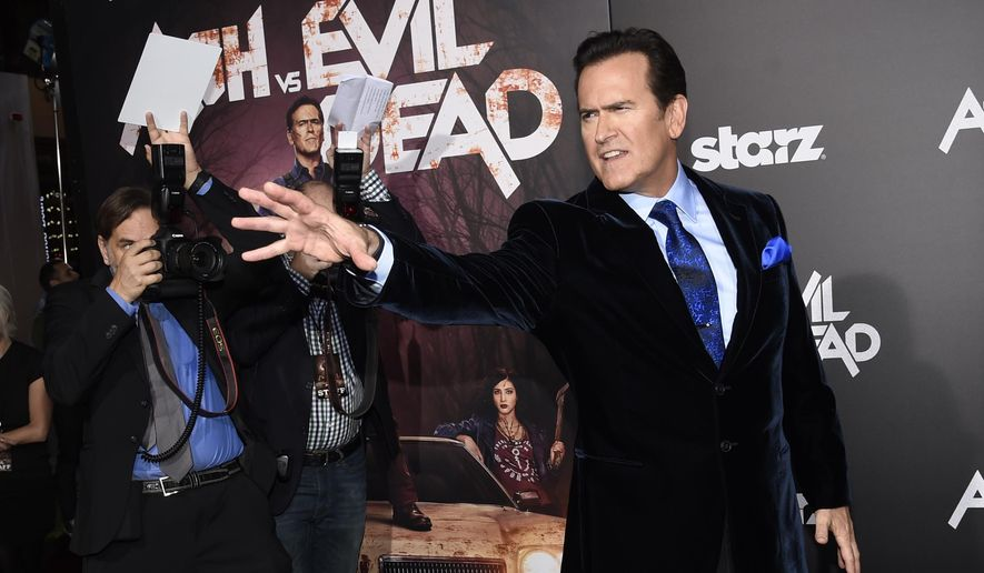 """FILE - In this Oct. 28, 2015, file photo, Bruce Campbell, a cast member in the Starz television series """"Ash vs Evil Dead,"""" strikes a pose for photographers at the premiere of the film at TCL Chinese Theatre in Los Angeles. Campbell took to Twitter on Tuesday, June 7, 2016, to shoot down a tweet from a conservative Twitter account showing a bloodied woman who it said was a Donald Trump supporter attacked by liberals. Campbell said it was actually a makeup test photo for Samara Weaver, one of his """"Ash"""" co-stars. (Photo by Chris Pizzello/Invision/AP, File)"""