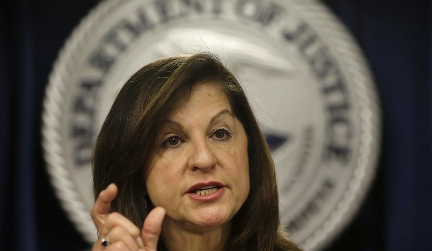 U.S. Attorney Carmen Ortiz responds to questions from reporters during a news conference at the federal courthouse, Thursday, June 9, 2016, in Boston. Law enforcement officials say more than 60 alleged gang members from Boston and other cities in eastern Massachusetts have been charged with drug, weapons and racketeering charges. (AP Photo/Steven Senne)