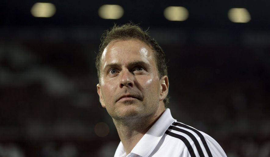 FILE - In this Sept. 26, 2012 photo then Leverkusen coach Sascha Lewandowski leaves the pitch prior to the German first division Bundesliga soccer match between FC Augsburg and Bayer 04 Leverkusen in Augsburg, southern Germany. (AP Photo/Matthias Schrader, file)