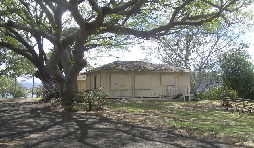 In this 2012 photo released by the National Park Service is a Pearl Harbor bungalow that was demolished in Honolulu. The National Park Service says it demolished a historic home at Pearl Harbor without consulting historic preservation authorities as required. Superintendent Jacqueline Ashwell said in an interview Thursday, June 9, 2016, the Park Service failed to provide appropriate oversight for the project, which began in November. (National Park Service via AP)