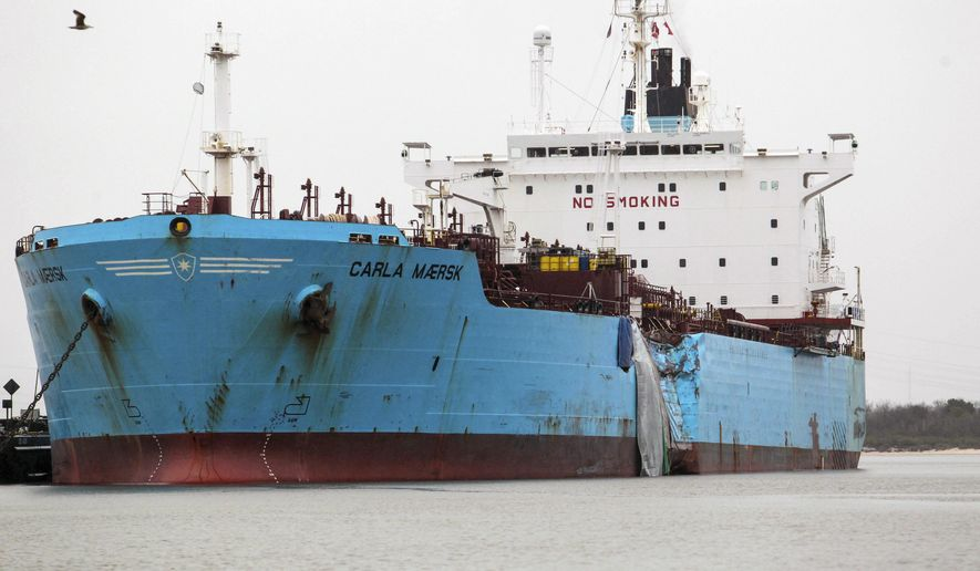 FILE - In this March 11, 2015, file photo, shows the damaged hull of the Carla Maersk, a chemical tanker in the Houston Ship Channel after a collision March 9 with another vessel. Federal safety experts said Wednesday, June 8, 2016, errors by the pilot of the Conti Peridot likely caused the collision with the Carla Maersk that led to a chemical spill. (Billy Smith II/Houston Chronicle via AP, File)