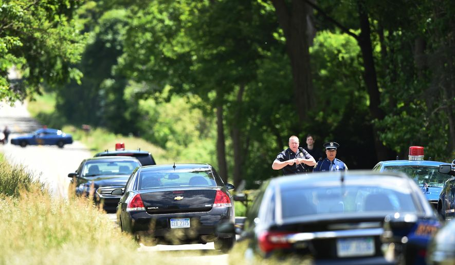 Police investigate near 13111 Town Road on Wednesday, June 8, 2016. Police in Jackson County's Springport Township say two 18-year-old men were found dead Wednesday near the rural home after officers responded to a call from a resident of the home.  (J. Scott Park/Jackson Citizen Patriot-Mlive.com via AP)