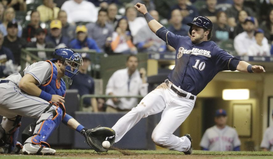 Milwaukee Brewers' Kirk Nieuwenhuis slides safely past New York Mets catcher Kevin Plawecki during the seventh inning of a baseball game Thursday, June 9, 2016, in Milwaukee. Nieuwenhuis scored from second on a hit by Hernan Perez. (AP Photo/Morry Gash)