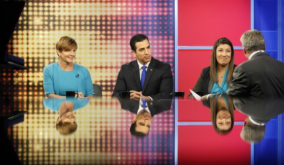 In this June 8, 2016, photo, Congressional candidates Susie Lee, from left, Ruben Kihuen and Lucy Flores take questions from journalist Jon Ralston, right, during a debate on Ralston Live, a PBS television show, in Las Vegas. The three are Democratic candidates for Nevada's 4th Congressional District. (AP Photo/John Locher)