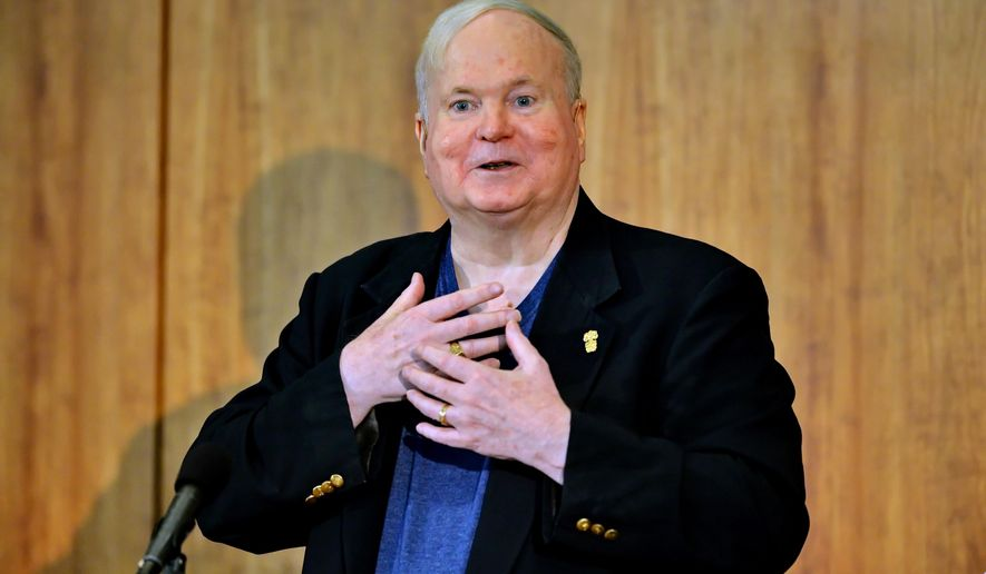 FILE - In this May 16, 2014, file photo, author Pat Conroy speaks to a crowd during a ceremony at the Hollings Library in Columbia, S.C. Barbra Streisand and John Grisham are among the honorary board members for a facility dedicated to the late Conroy. His publisher, Doubleday, told The Associated Press on Thursday, June 9, 2016, that the center will host readings, lectures and book groups; offer writing courses and scholarships; and help facilitate other educational programs. (AP Photo/ Richard Shiro, File)