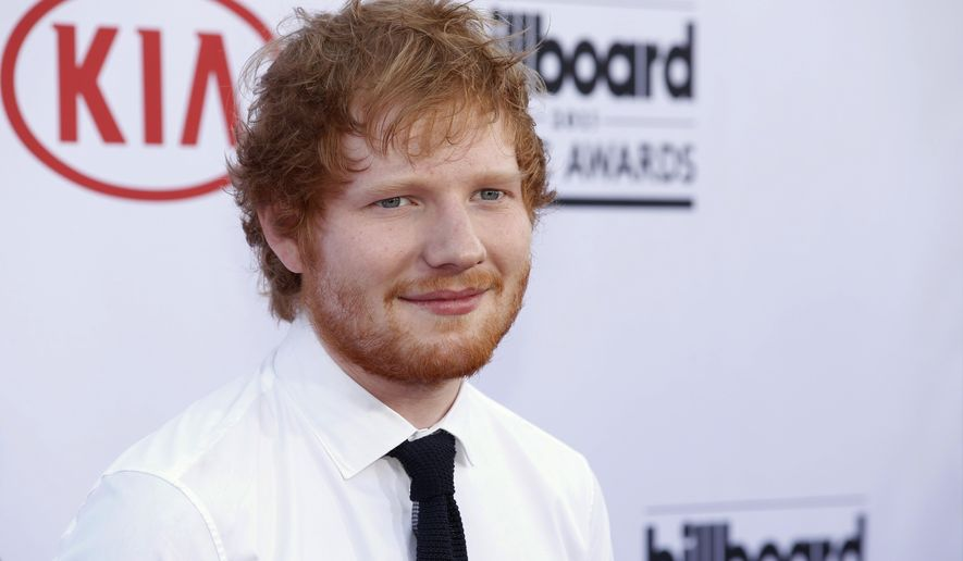 "FILE - In this May 17, 2015, file photo, Ed Sheeran arrives at the Billboard Music Awards at the MGM Grand Garden Arena in Las Vegas. Sheeran is facing a lawsuit alleging he used another song as the basis for his international hit ""Photograph"" filed Wednesday, June 8, 2016, in Los Angeles by Martin Harrington and Tom Leonard, composers of the song ""Amazing."" (Photo by Eric Jamison/Invision/AP, File)"