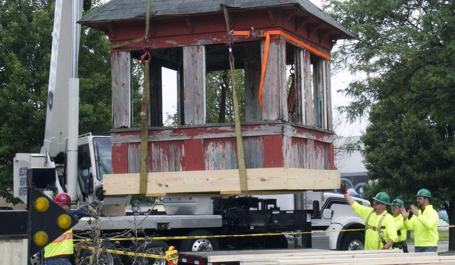 Workers remove the old railroad tower in Grand Rapids, Mich., Thursday, June 9, 2016. The dilapidated wooden shack was removed Thursday from its base and will be renovated or restored, depending on its condition.  (Cory Morse/The Grand Rapids Press via AP) ALL LOCAL TELEVISION OUT; LOCAL TELEVISION INTERNET OUT; MANDATORY CREDIT