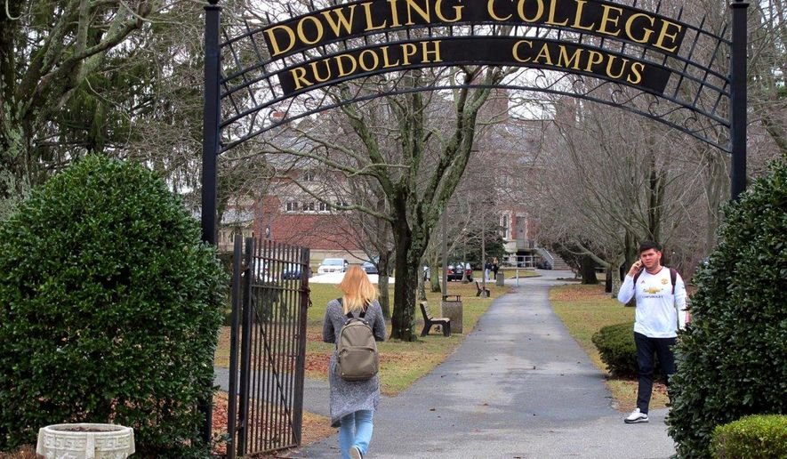 FILE - In this Feb. 4, 2016 file photo, students walk near the entrance to Dowling College in Oakdale, N.Y. The struggling liberal arts college on Long Island says it's staying open following negotiations with a London-based academic investment firm. (AP Photo/Frank Eltman, File)