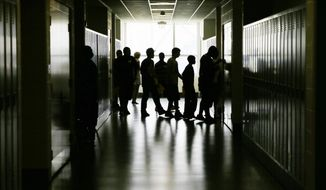 In this Aug. 29, 2013 file photo, students walk through the halls during an open house for incoming freshman and transfer students at a high school in Philadelphia. A new government survey released Thursday, June 9, 2016 finds a surprising drop in the proportion of high schools kids who are having sex. The survey found 41 percent said they had ever had sex, after it had been about 47 percent from a decade. (AP Photo/Matt Slocum)