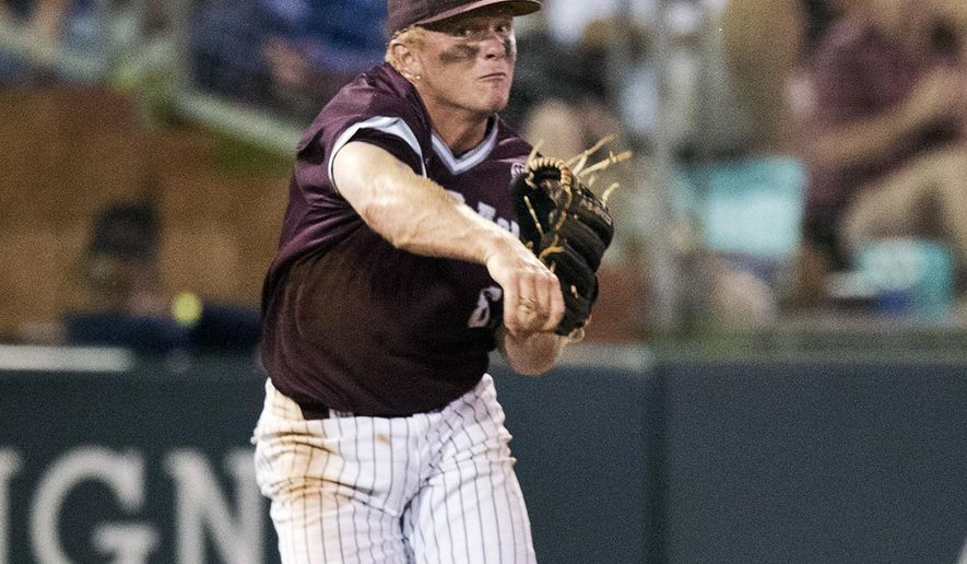 Texas A&M third baseman Boomer White makes a throw to first against Wake Forest during an NCAA Tournament Lubbock Regional college baseball game, Saturday, June 4, 2016, in College Station, Texas. Texas A&M defeated Wake Forest 22-2. (Timothy Hurst/College Station Eagle via AP) MANDATORY CREDIT