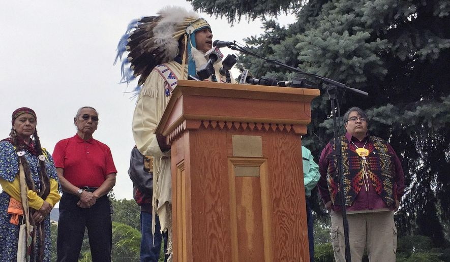 JoDe Goudy, chairman of the Yakama Nation, speaks to residents during a news conference held by Pacific Northwest tribes to condemn the transport of fossil fuels by rail through the Columbia River Gorge in this June 9, 2016, in Mosier, Ore. The fiery derailment of a Union Pacific oil train on June 3 led to evacuations and fear in this tiny river town and local tribes are also concerned about damage to the Columbia River. (AP Photo/Gillian Flaccus)