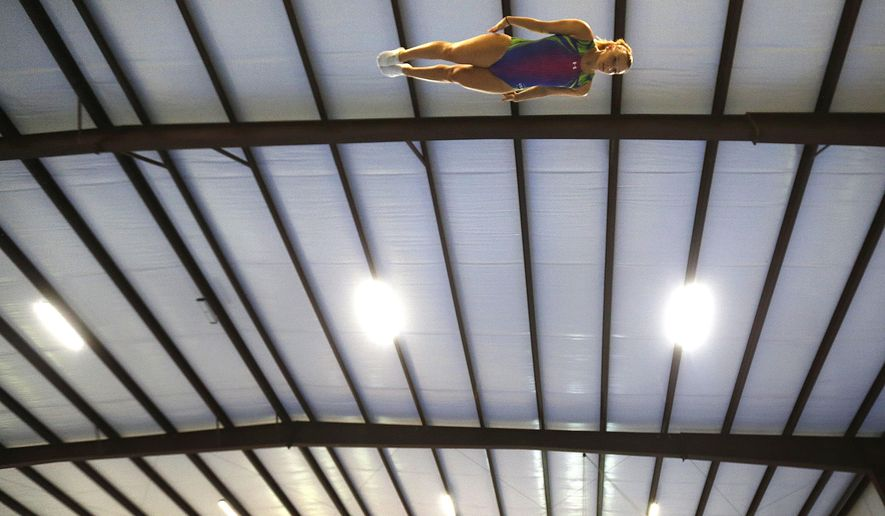Trampoline gymnast Nicole Ahsinger practices her routine in Lafayette, La., Wednesday, May 25, 2016. The trials that begin June 11 in Providence, R.I., will decide which man and woman will represent the United States this summer in Rio de Janeiro, and which will be the two alternates. (AP Photo/Gerald Herbert)