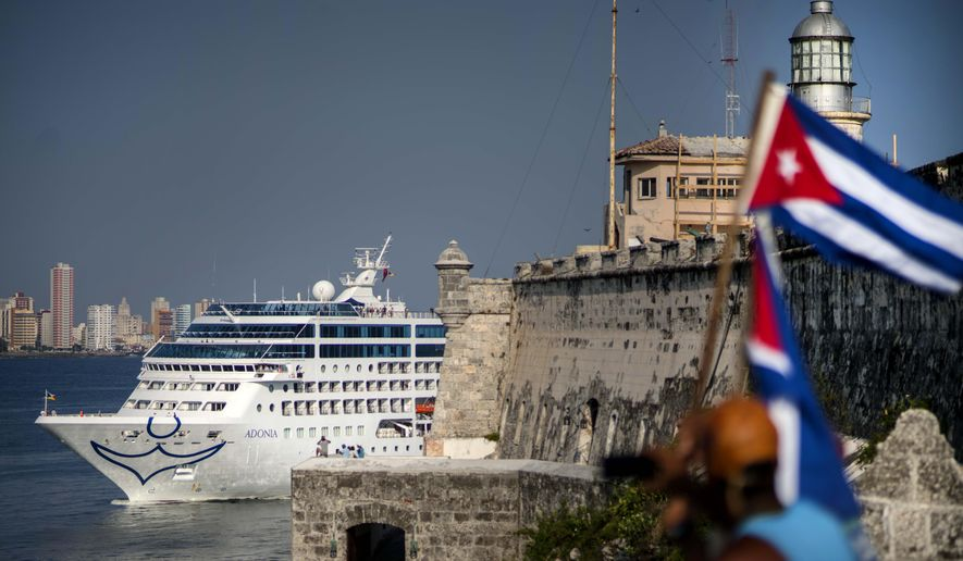 FILE - In this May 2, 2016 file photo, Carnival's Fathom cruise line ship Adonia arrives from Miami in Havana, Cuba. The Cuban itinerary, with its educational and cultural experiences, is not a typical cruise vacation, and feedback from passengers and travel agents about the Fathom's first few trips has been slightly mixed. (AP Photo/Ramon Espinosa, File)