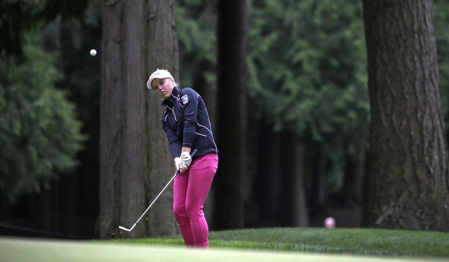 Brooke Henderson, of Canada, chips the ball during the first round of the Women's PGA Championship golf tournament at Sahalee Country Club Thursday, June 9, 2016, in Sammamish, Wash. (AP Photo/Elaine Thompson)