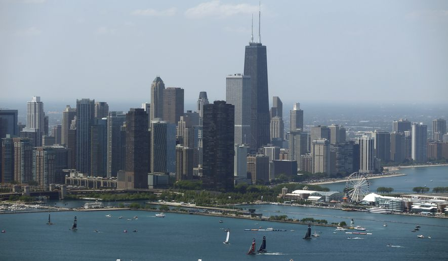 Sailboats practice in front of the downtown Chicago skyline, Friday, June 10, 2016, during practice for an America's Cup World Series sailing event, which will be held Saturday and Sunday. (AP Photo/Kiichiro Sato) ** FILE **