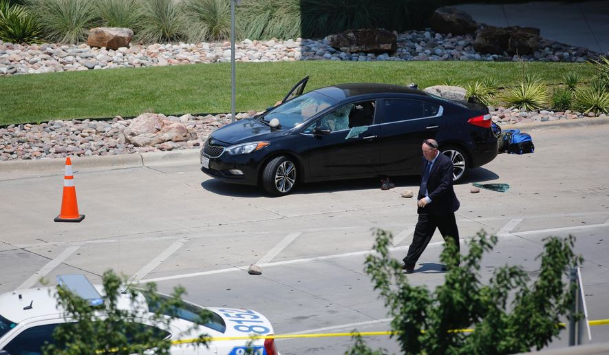 An investigator works the scene of an officer-involved shooting which prompted a lockdown at Dallas Love Field airport Friday, June 10, 2016, in Dallas.  (Tom Fox/The Dallas Morning News via AP) MANDATORY CREDIT; MAGS OUT; TV OUT; INTERNET USE BY AP MEMBERS ONLY; NO SALES