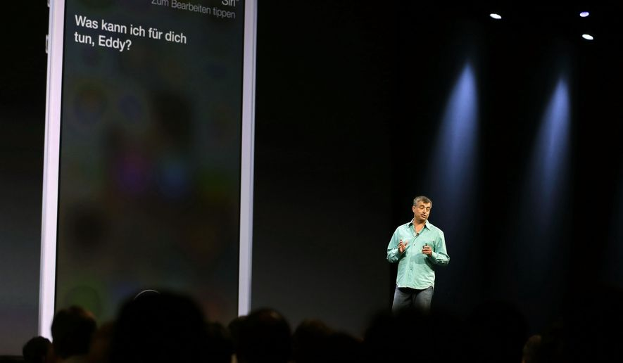 In this June 10, 2013, file photo, Eddy Cue, Apple senior vice president of internet software and services, talks about the new voices of Siri virtual assistant during the keynote address of the Apple Worldwide Developers Conference in San Francisco. (AP Photo/Eric Risberg, File)