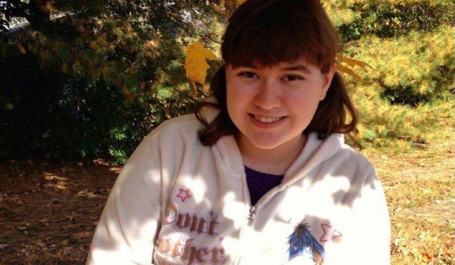 In this photo provided by Rebecca Guildford and taken sometime between 2014 and 2016, Hallee Sorenson, of Bangor, Maine, poses for a photo in the Bangor area. Guildford's Facebook post calling for people to help her autistic cousin have a better birthday has been shared more than 150,000 times on the social media website. (Allyson Seel-Sorenson/Courtesy of Rebecca Guildford via AP)