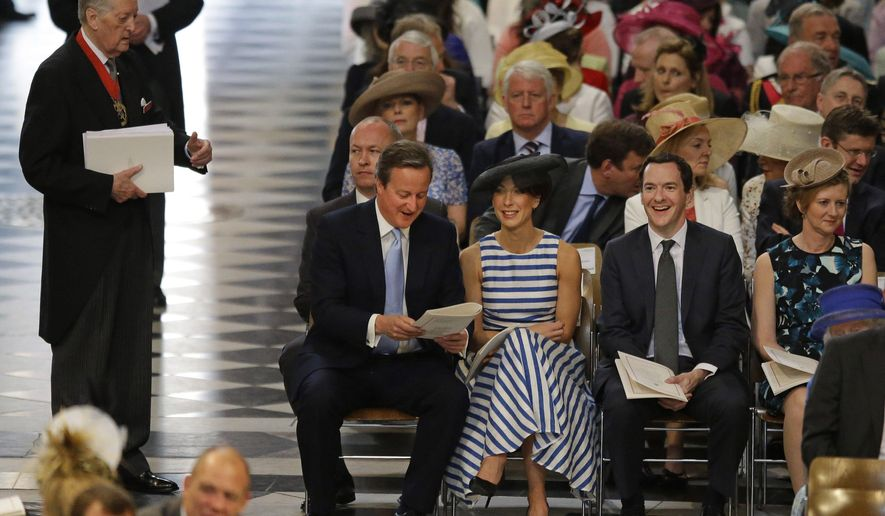 Britain's Prime Minister David Cameron, second left, his wife Samantha and Chancellor George Osborne take their seats for a National Service of Thanksgiving to mark the 90th birthday of Britain's Queen Elizabeth II at St Paul's Cathedral in London, Friday, June 10, 2016. Queen Elizabeth II is celebrating her official 90th birthday with a three-day series of festivities starting Friday, on what is also her husband Prince Philip's 95th birthday. The queen's real birthday is in April. (AP Photo/Matt Dunham, Pool)