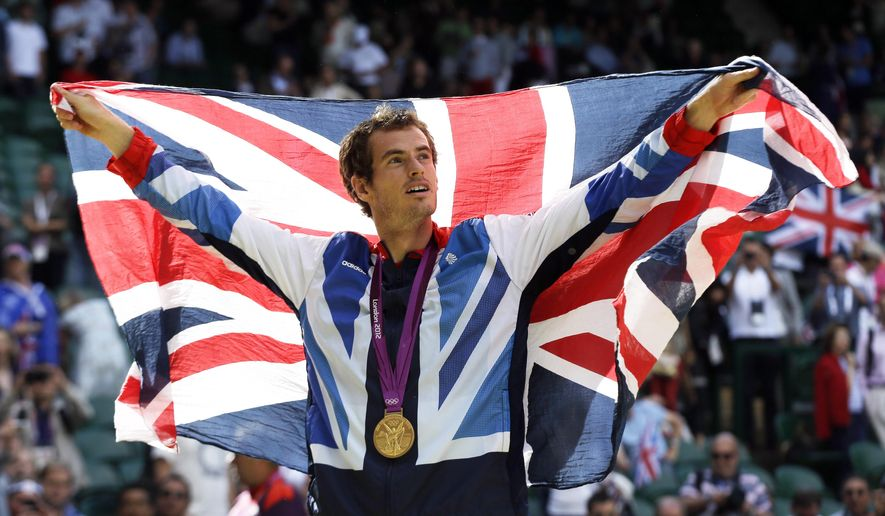 FILE - In this Sunday, Aug. 5, 2012 file photo, gold medalist Andy Murray of Great Britain waves the British flag during the medal ceremony of the men's singles event at the All England Lawn Tennis Club at Wimbledon, in London, at the 2012 Summer Olympics. Defending Olympic champion Andy Murray will lead a four-member British tennis team at the Rio de Janeiro Games. (AP Photo/Elise Amendola, file)