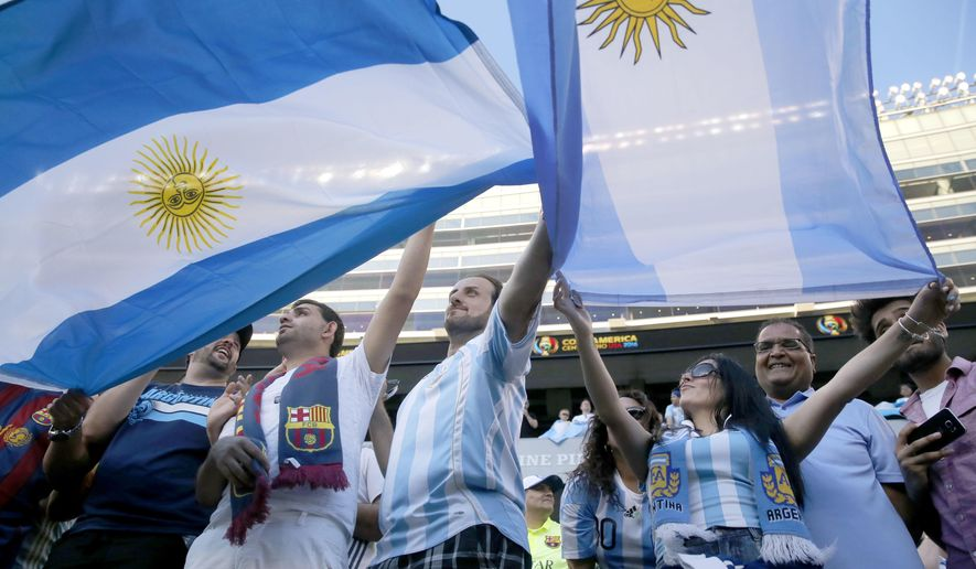 Fans of the Argentinian soccer team wait for their arrival before a Copa America Centenario group D soccer match at Soldier Field between Argentina and Panama Friday, June 10, 2016, in Chicago. (AP Photo/Charles Rex Arbogast)