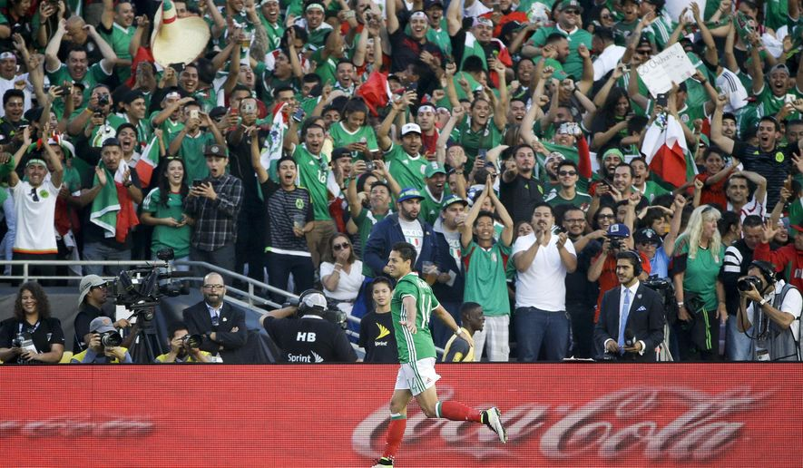 Mexico's Chicharito, left, celebrates his goal against Jamaica during the first half of a Copa America Centenario Group C soccer match at the Rose Bowl, Thursday, June 9, 2016, in Pasadena, Calif. (AP Photo/Jae C. Hong)