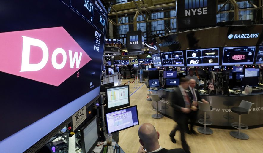 FILE - In this Dec. 9, 2015 file photo, the company names of Dow, left, and Dupont, right, appear above their trading posts on the floor of the New York Stock Exchange.  DuPont and Dow Chemical said Friday, June 10, 2016 that they will hold separate shareholder meetings next month to vote on their merger. Both meetings will be held on July 20. DuPont's meeting will take place at its Wilmington, Delaware, headquarters, and Dow Chemical's meeting will be at its Midland, Michigan, offices.  (AP Photo/Richard Drew)
