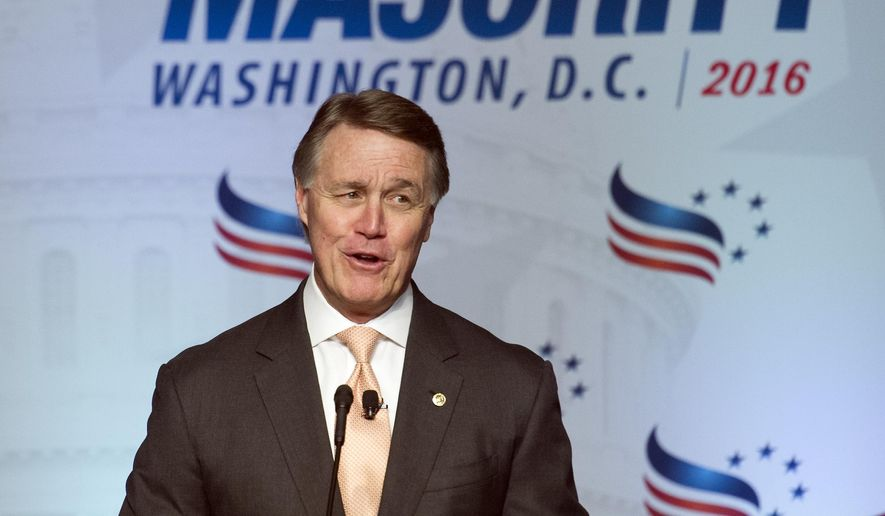 "Sen. David Perdue, R-Ga. addresses the Road to Majority Conference in Washington, Friday, June 10, 2016. Perdue told conservatives they should pray for President Barack Obama and suggested a biblical passage that says, ""Let his days be few."" (AP Photo/Cliff Owen)"