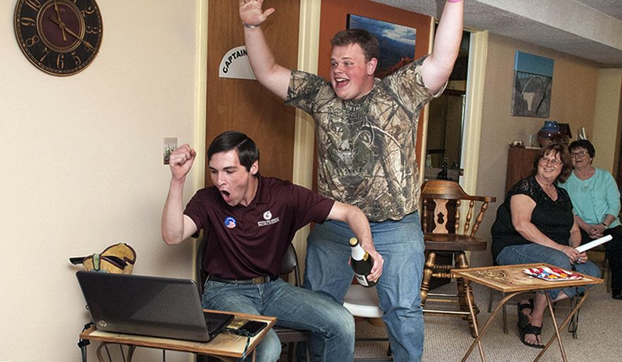 In this Tuesday, June 7, 2016 photo, Jacob Bachmeier, seated, and his campaign manager Daniel Almas, both 18 and recently graduated from high school, celebrate during Tuesday's Montana primary in Havre after learning that Bachmeier has advanced to the November general election for a House seat in the Montana Legislature. Bachmeier, a Democrat, is trying to unseat the Republican incumbent, Rep. Stephanie Hess, to become the youngest member of next year's Legislature. (Teresa Getten/Havre Daily News via AP)