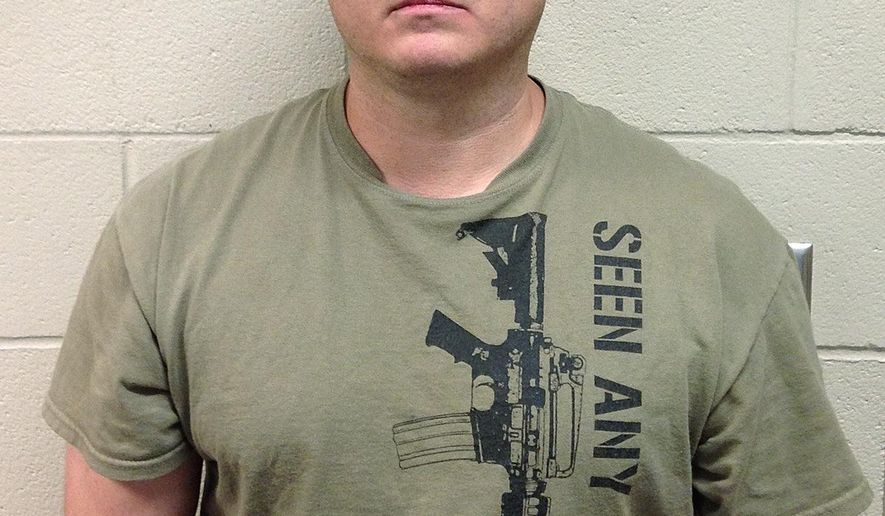 In this June 2016 photo released by the Hoke County (N.C.) Sheriff's Office, Thomas Russell Langford poses for a booking photograph. Langford, has been charged with ethnic intimidation and assault with a deadly weapon, among other counts. A North Carolina sheriff says a series of threats to a mosque began when members noticed someone had left packages of bacon at the door. The sheriff says the driver of the vehicle later made death threats to members of the mosque. (Hoke County Sheriff's Office via AP)