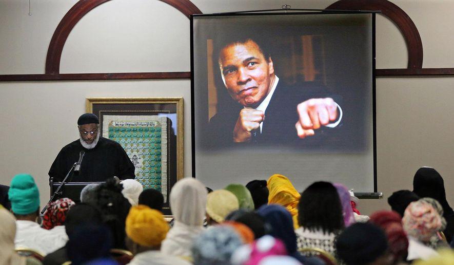Imam Nadim Ali delivers the closing remarks during an interfaith memorial service for Muhammad Ali at the Atlanta Masjid of Al-Islam on Thursday, June 9, 2016, in Atlanta.  (Curtis Compton/Atlanta Journal-Constitution via AP)