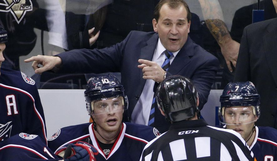 FILE - In this Dec. 13, 2014, file photo, Columbus Blue Jackets coach Todd Richards talks with an official during an NHL hockey game against the Pittsburgh Penguins in Columbus, Ohio. Richards has had plenty of time to plot his next adventure after the Blue Jackets fired him in October. Richards decided to join the Tampa Bay Lightning as an assistant as part of a bevy of moves over the past two weeks. (AP Photo/Gene J. Puskar, File)