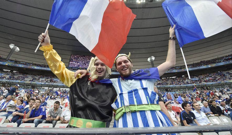 Supporters of France wave flags on the stands before the Euro 2016 Group A soccer match between France and Romania, at the Stade de France, in Saint-Denis, north of Paris, Friday, June 10, 2016. (AP Photo/Martin Meissner)