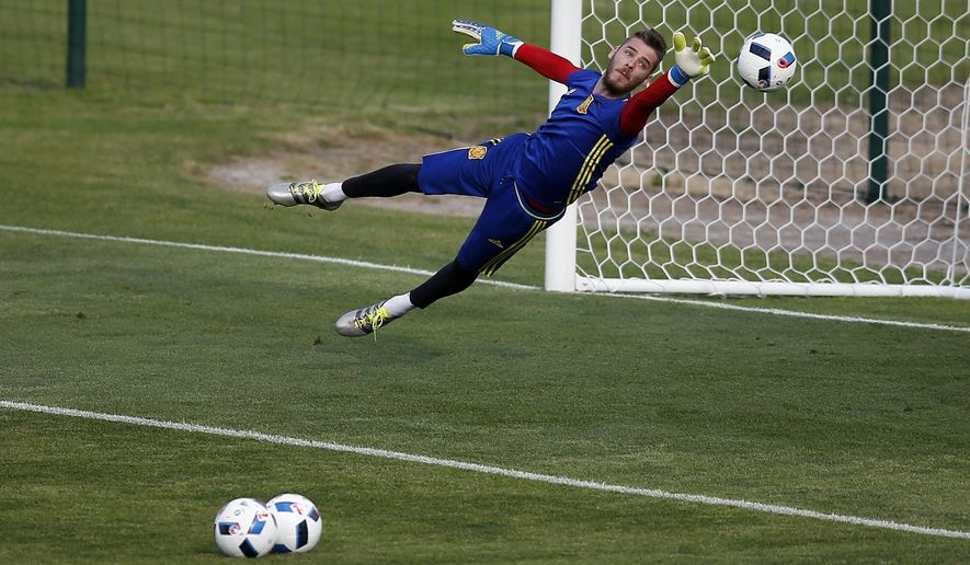 Spain's goalkeeper David De Gea tries to save the ball during a training session at the Sports Complex Marcel Gaillard in Saint Martin de Re in France, Thursday, June 9, 2016. Spain will face against Czech Republic in a Euro 2016 Group D soccer match in Toulouse on Monday, June 13. (AP Photo/Manu Fernandez)
