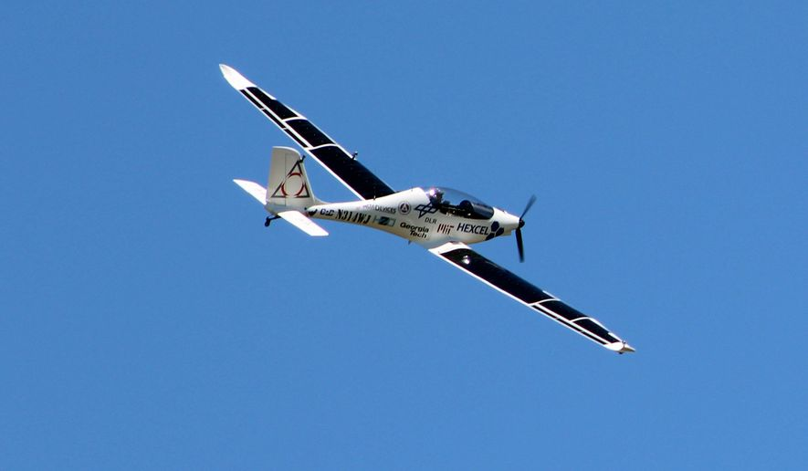 Test pilot Robert Lutz flies the solar-powered Luminati Aerospace VO-Substrata prototype aircraft, in Calverton, N.Y., Friday, June 10, 2016. Lutz flew the aircraft for about 20 minutes for a New York company that envisions manufacturing a fleet of drones to provide aerial internet service for an estimated four billion people worldwide. (AP Photo/Frank Eltman)