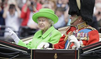 "Britain's Queen Elizabeth II and Prince Philip ride in a carriage during the Trooping The Colour parade at Buckingham Palace, in London, Saturday, June 11, 2016. Hundreds of soldiers in ceremonial dress have marched in London in the annual Trooping the Colour parade to mark the official birthday of Queen Elizabeth II. The Trooping the Colour tradition originates from preparations for battle, when flags were carried or ""trooped"" down the rank for soldiers to see. (AP Photo/Tim Ireland) ** FILE **"
