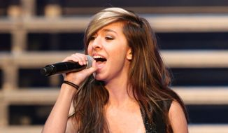 "In this June 29, 2014 file photo, ""The Voice"" Season 6 contestant Christina Grimmie performs as part of ""The Voice Tour"" at Cobb Energy Centre, in Atlanta. (Photo by Robb D. Cohen/Invision/AP, File)"