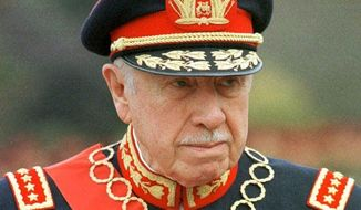 FILE - In this March 10, 1998 file photo, former Chilean dictator Gen. Augusto Pinochet is shown in Santiago, Chile. The ghosts of Chile's four-decade-old, bloody coup d'etat, which led to the torture, and disappearance of thousands of political opponents, are coming to an Orlando, Florida courtroom with the start of a civil trial involving a military commander and the family of Victor Jara. The family of Jara is suing Lt. Pedro Pablo Barrientos Nunez, a former military officer in the regime of Gen. Augusto Pinochet for damages, claiming that Barrientos Nunez was in charge of the stadium where Jara was tortured and killed in 1973. The trial starts in Orlando, Fla., Monday, June 13. 2016.(AP Photo/Santiago Llanquin, File)