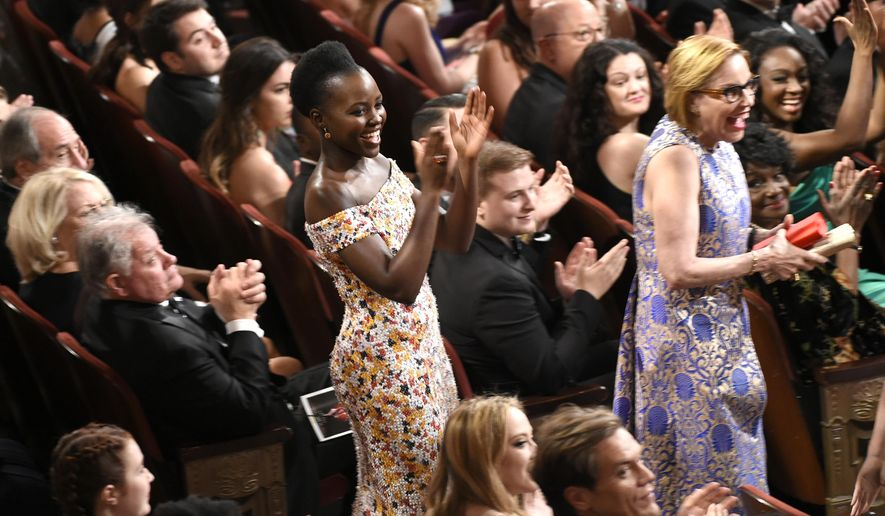 Lupita Nyong'o applauds in the audience at the Tony Awards at the Beacon Theatre on Sunday, June 12, 2016, in New York. (Photo by Evan Agostini/Invision/AP)