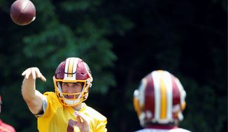 Washington Redskins quarterback Kirk Cousins was sharp on his passes during organized team activities last week. (Associated Press)