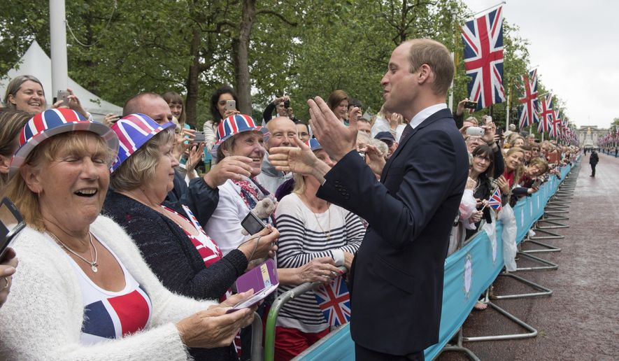 "Britain's Prince William meets well-wishers, as members of the royal family walk along The Mall during ""The Patron's Lunch"" event on Sunday June 12, 2016, in London.  The street party for 10,000 people and a parade on Sunday, is to celebrate the Queen's 90th birthday and mark her patronage of more than 600 charities and organisations. (Arthur Edwards/POOL via AP)"