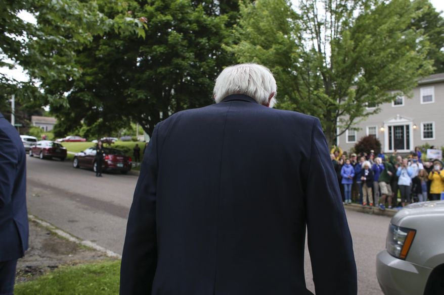 Democratic presidential candidate, Sen. Bernie Sanders, I-Vt., heads over to a group of supporters after speaking at a news conference outside his home Sunday, June 12, 2016, in Burlington, Vt. (AP Photo/Cheryl Senter)