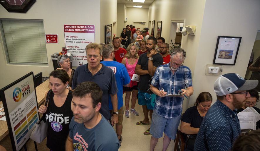 Donors line up outside OneBlood Blood Donation Center in Orlando, Fla., on Sunday, June 12, 2016. The center was flooded with donors after a mass shooting early Sunday morning at a gay nightclub, Pulse, in Orlando. (Loren Elliott/Tampa Bay Times via AP)